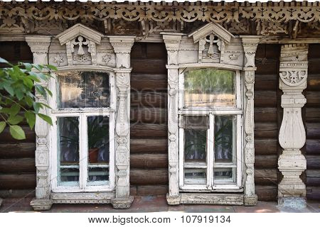 The Facade Of The Old Wooden Houses With Carved Architraves