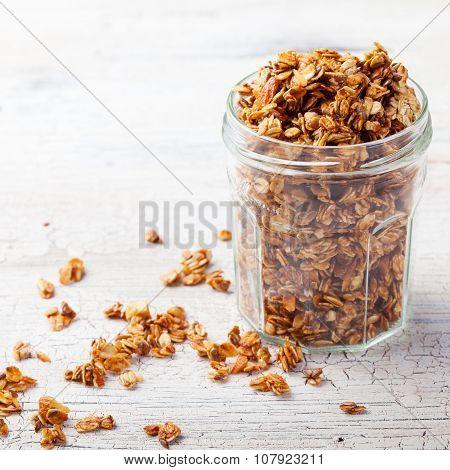 Healthy breakfast. Fresh granola, muesli in a glass jar.