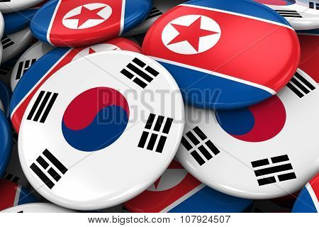 Flag Badges Of South Korea And North Korea In Pile - Concept Image For South Korean And North Korean
