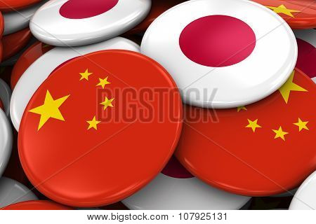Flag Badges Of China And Japan In Pile - Concept Image For Chinese And Japanese Relations