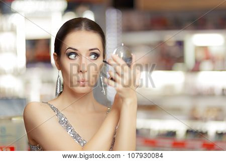 Surprised Woman with Mascara and Make-up Mirror