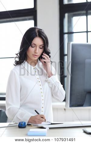 Job, secretary. Beautiful woman in the office