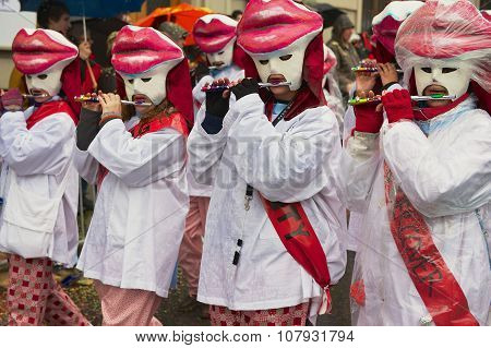 Women play flutes at Basel Carnival in Basel, Switzerland.