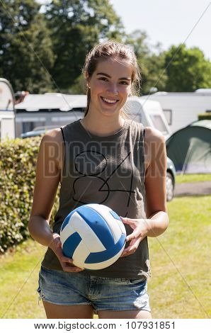 Beautiful woman with a ball in het hands