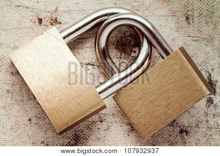 Two Linked Padlocks
