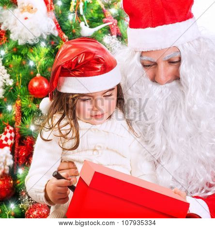 Portrait of cute little girl receive gift box from Santa Claus, celebrating Christmas at home near beautiful decorated evergreen tree