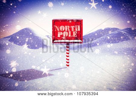 Continents against snowy land scape with pole
