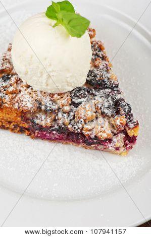 Crumble pie with black currants. English dessert with creamy ice cream