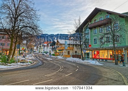 GARMISCH-PARTENKIRCHEN GERMANY - JANUARY 06 2015: Beautiful Alpine town of Garmisch-Partenkirchen with colorful houses and snow-covered mountains in the background