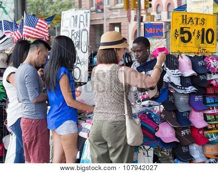 NEW YORK,USA - AUGUST 13,2015 : Tourists shopping for souvenirs in New York City
