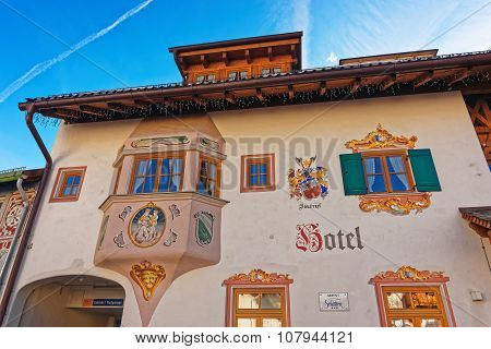 GARMISCH-PARTENKIRCHEN GERMANY - JANUARY 06 2015: Fragment of the facade of a hotel in Garmisch-Partenkirchen beautifully adorned with religious and historic painted scenes