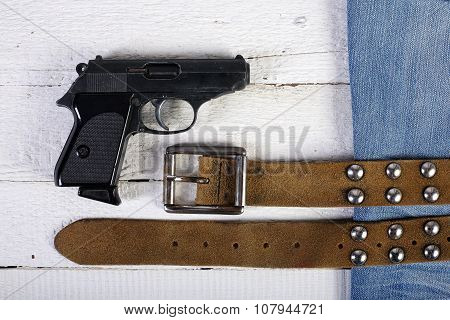 Planks, Gun, Blue Jeans And Belt
