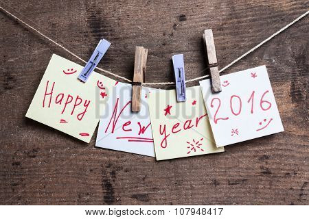 Happy New Year card on wooden surface
