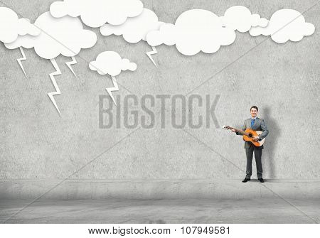 Businessman play guitar