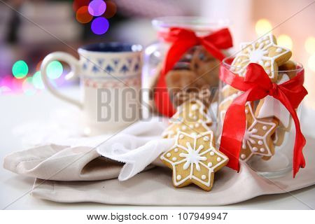 Christmas cookies and cup of tea, on table at home
