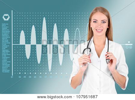 Young beautiful doctor with cardiogram