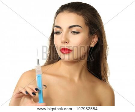Young beautiful woman holding syringe, isolated on white