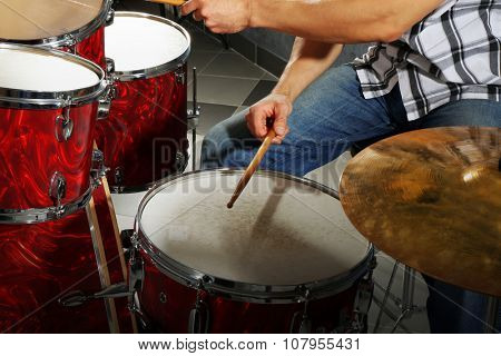 Musician playing the drums closeup