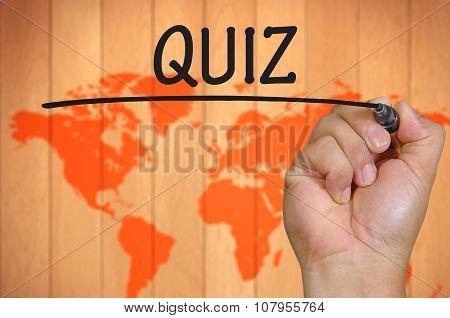 Hand Writing Quiz Over Blur World Background