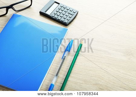 Workplace - stationery on grey wooden background