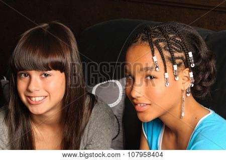 cute African American girl and Caucasian girl friend
