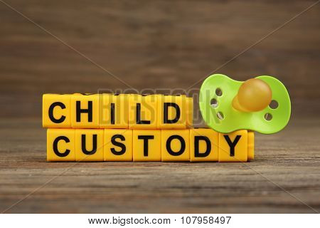 A dummy and blocks with letters regarding child-custody and family-law concept