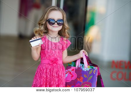 A young buyer with colored bags and credit card