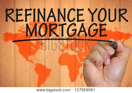 Hand Writing Refinance Your Mortgage Over Blur World Background