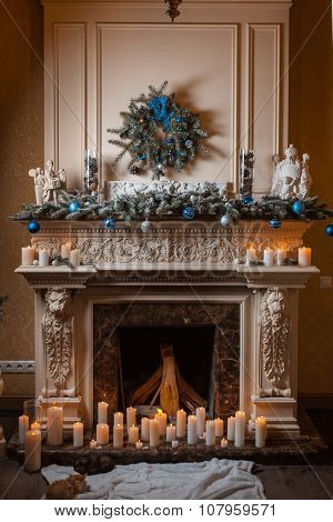 Christmas Fireplace With Candles And Decorations