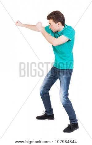 back view of skinny guy funny fights waving his arms and legs. Isolated over white background. Rear view people collection.  backside view of person. Funny guy clumsily boxing.