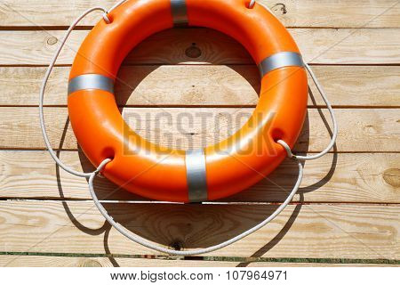 A life buoy on wooden background