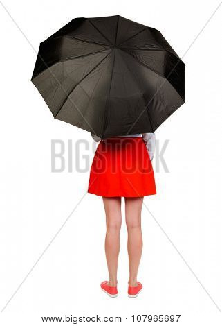 young woman under an umbrella. Rear view people collection.  backside view of person.  Isolated over white background. The girl in the red skirt is closing umbrella.