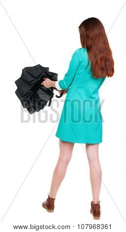 young woman with umbrella. Rear view people collection.  backside view of person.  Isolated over white background. The girl in a blue dress with brown boots collects umbrella