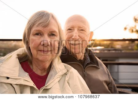 Grinning Couple In Jackets