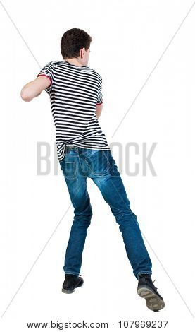 back view of skinny guy funny fights waving his arms and legs. Isolated over white background. Rear view people collection.  backside view of person.