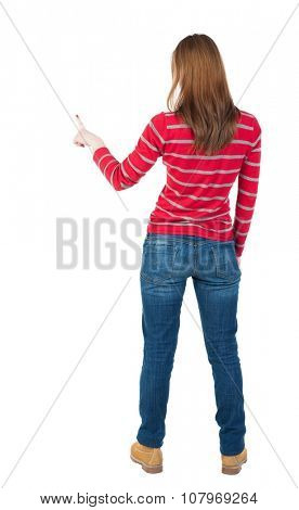 Back view of  pointing woman. beautiful girl. Rear view people collection.  backside view of person.  Isolated over white background. The blonde in a red striped sweater right thumb presses the button