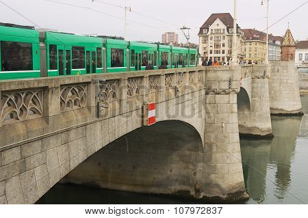 Tram passes by the bridge over Rhine river in Basel, Switzerland.