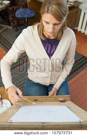 A Young Girl Paints On An Easel In The Studio Of The Artist
