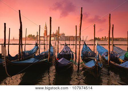 Venice with famous gondolas at gentle pink sunrise light, Italy, European landmark
