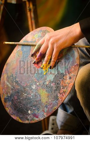 Palette in a painter's hand