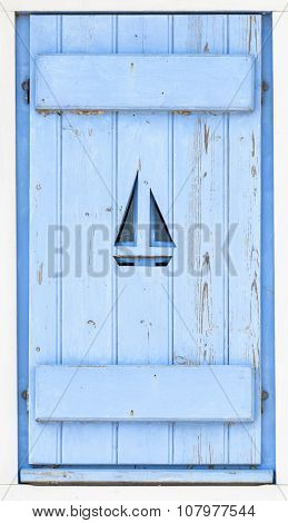 Sail boat on blue wooden shutter