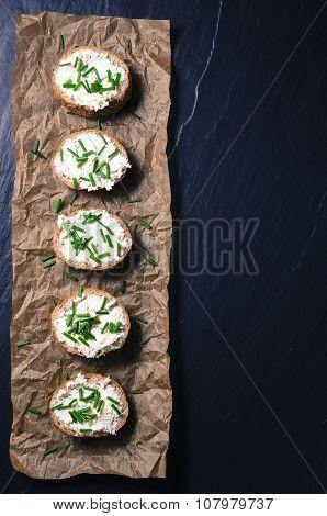 Mini sandwiches on dark background. Top view