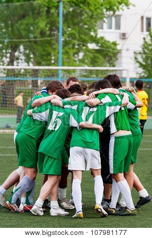 Members Of The Football Team Embrace After Winning The Match. Amateur Football In The Open Air.