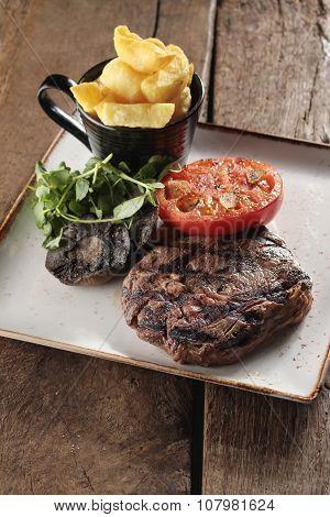 plated beef steak dinner