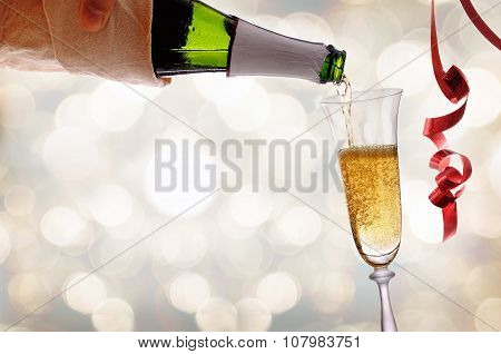 Waiter Serving A Glass Of Sparkling White Wine With Bokeh