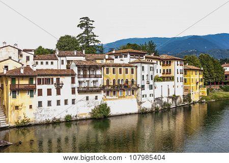 Facade Of Houses At River Brenta With Village Basano Del Grappa