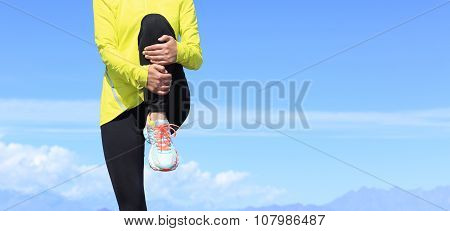 young fitness woman runner stretching before running