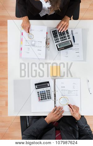 Two Businesspeople Inspecting Financial Expenses