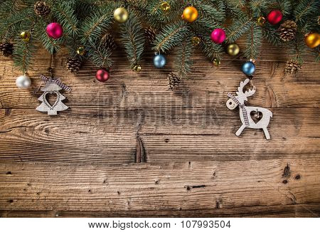 Abstract Christmas background with spruce branches on old wooden table.
