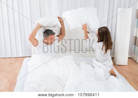 Couple Fighting With Pillow